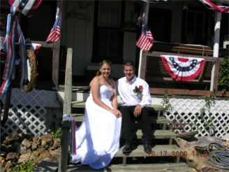 Dee & Keith on steps House 120 years+