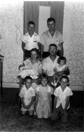 Joe, Ed   Helen holding Helen, Ed with Mary Ann Larry, Dolores, Gene  June 1955