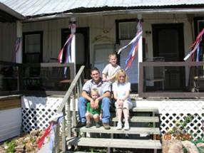 "Kevin, Sherry, Tyler and Ryan Okonskis  in Oct 2009 – ""Okonski HomePlace"" (same step area, porch, columns, doors, and windows as 1880's)"