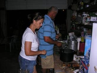 Helen and Larry Stuffing Jars